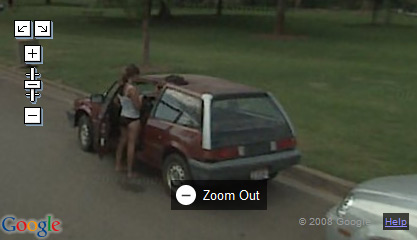 Girl changing clothes by the car