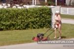 Estonian lady in bikini mows the lawn