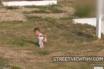 Little kid pretending to p**p on a church lawn