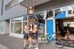 Cheerleaders in white mask at bike store