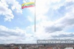 The Lithuanian flag flies over the city