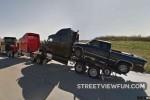 A truck carrying a truck carrying a truck carrying a pick ...