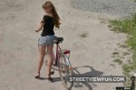 Girl with high heels and a bike