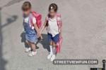 Schoolchildren holding hands and a... phone?