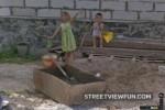 Ukranian kids in a sandbox say hi to Google